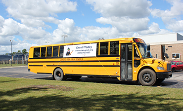 Bus With Banner That Says Enroll Now