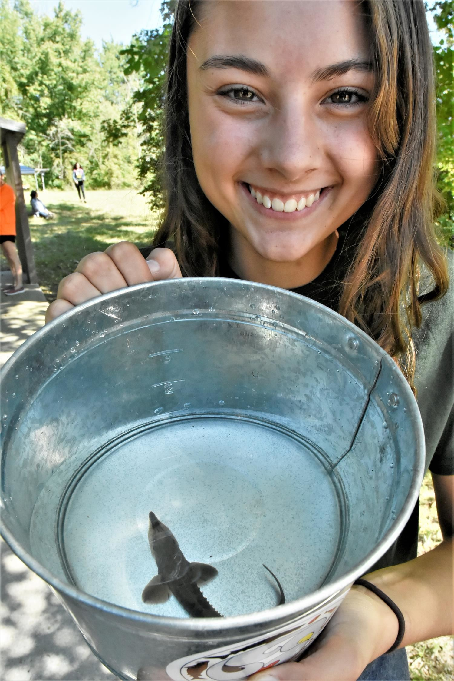 Girl with fish and bucket