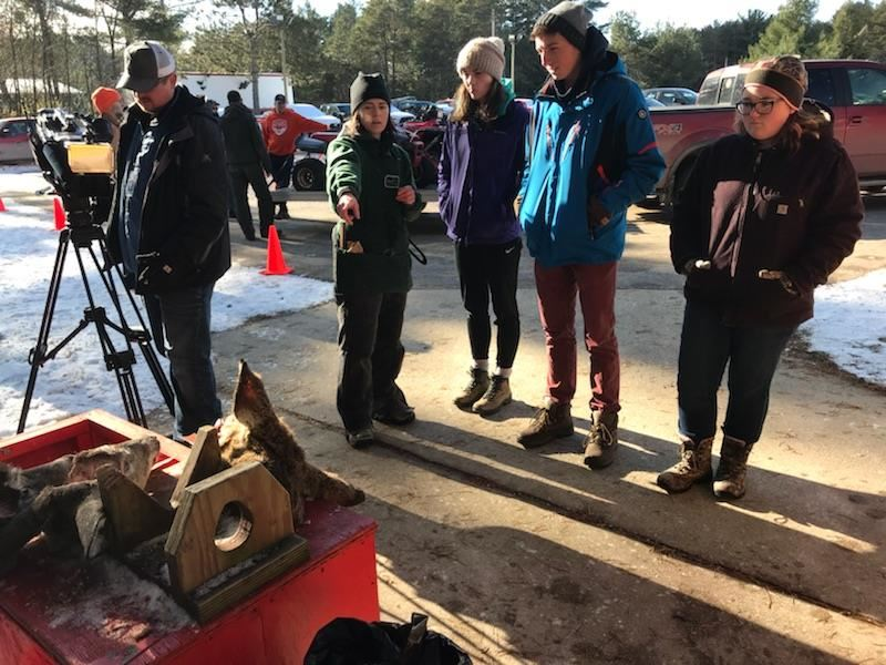 Students check in deer with the DNR