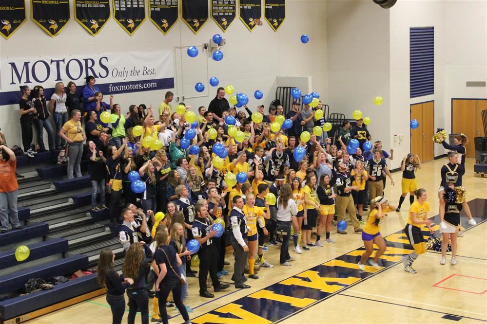 Gymnasium photo with students tossing balloons