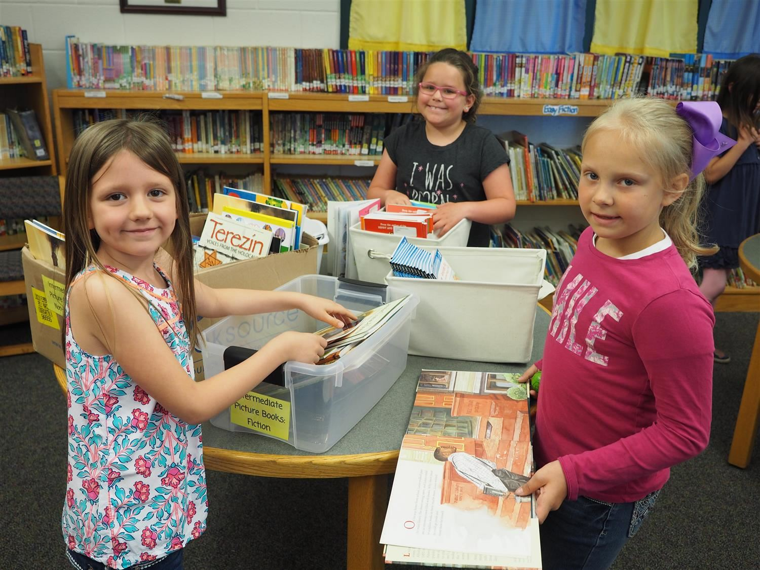 Students select their books for summer reading